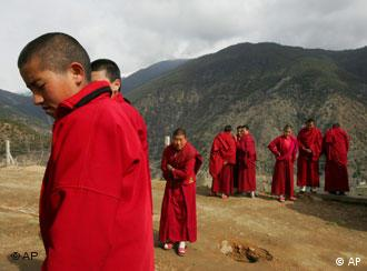 Tibetan nuns stand outside the Taibaling Nunnery at Shusong Village in the mountains about 50 kilometers (31 miles) from the border with Tibet, in China's southwest Yunnan province Tuesday March 25, 2008. The nunnery was rebuilt on the site of a 300-year-old monastery after the monastery and the nearby nunnery were destroyed during China's 1966-76 Cultural Revolution. Some 130 Tibetan nuns currently study at the nunnery. (AP Photo/Greg Baker)