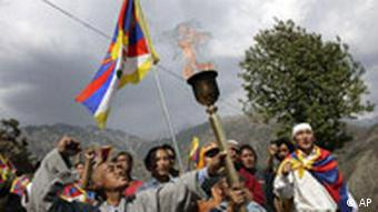 Protestors waving Tibetan flag