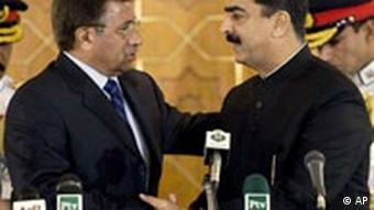 Pakistan's President Pervez Musharraf, left, greets Prime Minister Yousaf Raza Gilani