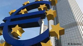 A euro sign surrounded by stars in front of the European Central Bank in Frankfurt