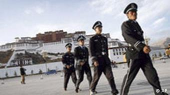Chinese soldiers patrol in front of the Potala Palace in Lhasa