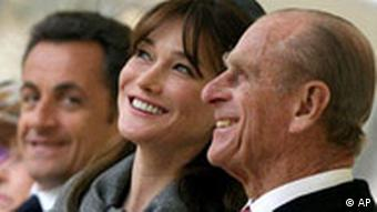 Carla Bruni-Sarkozy and Prince Philip share a joke as she and her husband watch the ceremonial welcome at Windsor Castle