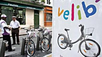 A sign for the Velib program is shown next to two men in front of bikes
