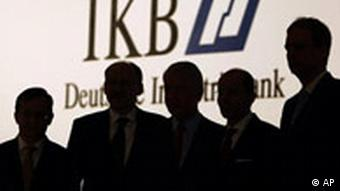 Board members of Deutsche Industriebank AG, IKB, Reinhard Grzesik, Dieter Glueder, supervisory board chairman Ulrich Hartmann, CEO Guenther Braeuning and board member Claus Momburg in silhouette
