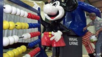 A Mickey Mouse wearing a doctor's hat stands by an abacus