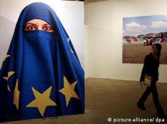 A woman wearing a face-covering made of the European flag
