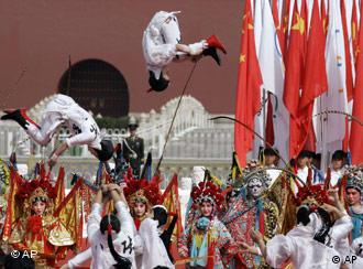 Acrobats perform at the Beijing 2008 Olympic torch lighting ceremony