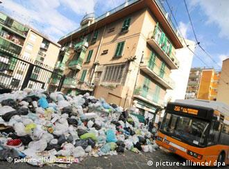 A city bus drives by a mountain of garbage in a suburb of Naples