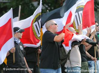 Right-wing extremists attend a NPD rally in Frankfurt am Main