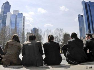 Business people sit during their luch break in downtown Frankfurt