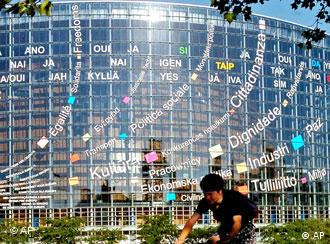 ** FILE ** A cyclist rides past the European Parliament building, with its facade covered with slogans promoting the European Constitution in several languages, in Strasbourg, eastern France, May 25, 2005. The parliament marks its 50th anniversary Wednesday, March 12, 2008, amid applause for its transformation yet also deep questions about the costs of its upkeep, its vulnerability to pressures from lobby groups and its competence in a continent where euroskepticism is on the rise. (AP Photo/Christian Lutz)