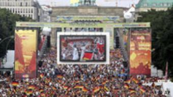Fans in Berlin on the Fan Mile at the Brandenburg Gate watch a 2006 World Cup game