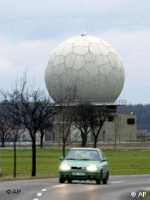 Passenger car rides around a newly built NATO air-defense radar base near Nepolisy, some 85 kilometers (53 miles) east from Prague, Czech Republic