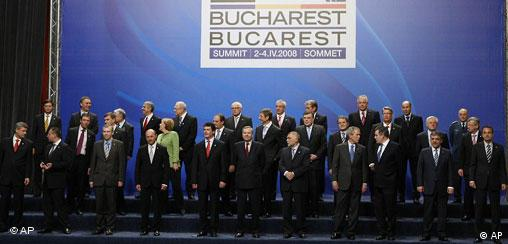 Leaders of the NATO alliance gather for an official photo, at the NATO Summit conference in Bucharest