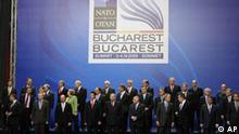 Leaders of the NATO alliance gather for an official photo, at the NATO Summit conference in Bucharest, Thursday April 3, 2008. The NATO allies agreed to put off a plan to put Ukraine and Georgia on track to join the alliance, but did invite Albania and Croatia to become members.(AP Photo/Gerald Herbert)