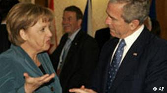 US President George W. Bush talks with German Chancellor Angela Merkel