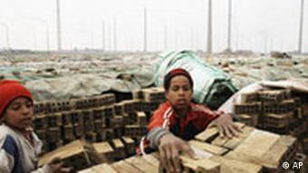 Egyptian Ahmed Gomma, right, 14-year old with another young worker at the a brick factory in the suburb of Helwan, Cairo, Egypt in 2008