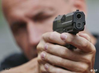 Man aims a pistol