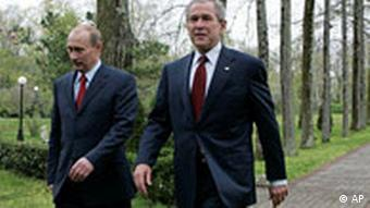 Russian Prime Minister Vladimir Putin, left, and US President George Bush, right