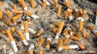 An ashtray filled with cigarette butts