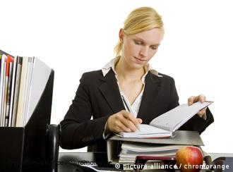 Blonde woman at a work desk
