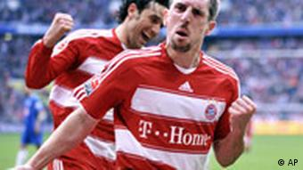Munich players Franck Ribery, front, and his teammate Luca Toni, left, celebrate after his penalty kick during the German first division Bundesliga soccer match between FC Bayern Munich and VfL Bochum in Munich, southern Germany, on Sunday, April 6, 2008. (AP Photo/Christof Stache) ** Eds note German spelling of Munich is Muenchen. ** NO MOBILE USE UNTIL 2 HOURS AFTER THE MATCH, WEBSITE USERS ARE OBLIGED TO COMPLY WITH DFL-RESTRICTIONS, SEE INSTRUCTIONS FOR DETAILS **