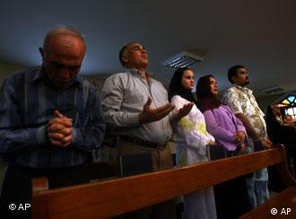 Iraqi Christians pray during a Sunday mass in Baghdad