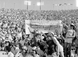 Fans at the Los Angeles Memorial Coliseum display a banner proclaiming: to Russia With Love! Having a Great Time/Wish You Were Here/From all of US on Sunday, August 5, 1984.