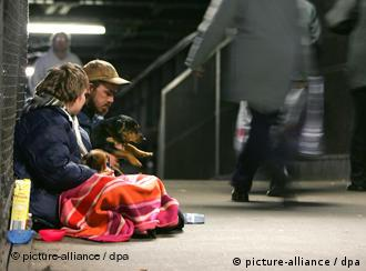 A homeless couple sitting in an underground station