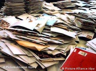 An overflowing pile of mail