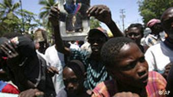 Haitians gather at a police barricade in front of the parliament in 2008