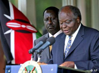 Opposition leader Raila Odinga, left, looks on as Kenyan President Mwai Kibaki, right, announce the cabinet and Odinga as the Prime Minister, Sunday, April 13, 2008 at State House in Nairobi, Kenya. President Mwai Kibaki on Sunday named rival Raila Odinga as prime minister, implementing a power-sharing deal after protracted negotiations over the deal they signed over a month ago.(AP Photo/Karel Prinsloo)
