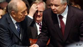 Peres and Kaczynski shake hands during ceremonies marking the 65th anniversary of the Warsaw Ghetto Uprising