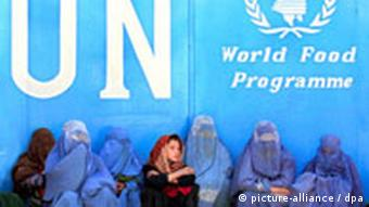 Women sitting in front of the UN Food Program building in Kabul