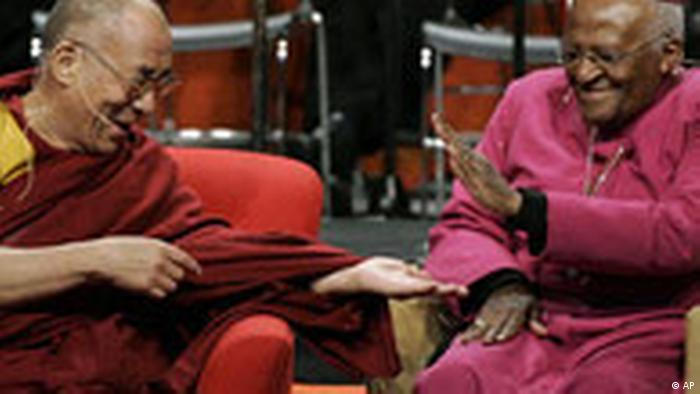 The Dalai Lama, left, slaps palms with Archbishop Desmond Tutu, of South Africa, during one of many lighthearted moments as they speak at a panel discussion addressing the topic of inspiring spiritual compassion in youth Tuesday, April 15, 2008 at the University of Washington in Seattle. (AP Photo/Ted S. Warren)
