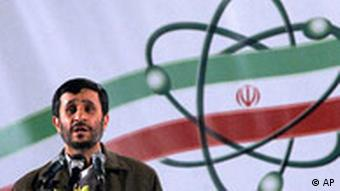 Iranian President Mahmoud Ahmadinejad in front of an Iranian flag with an atomic symbol