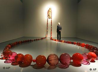 An out-sized red rosary on display in Duesseldorf