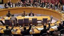 The U.N. Security Council unanimously votes to approve a resolution at U.N. headquarters in New York, Wednesday Nov. 14, 2001. The resolution endorses efforts to fill a political vacuum in Afghanistan and provide security for the vast areas of the country captured by anti-Taliban forces. (AP Photo/Osamu Honda)