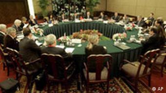 Delegates from Russia, France, Germany, Great Britain, the U.S., China and the European Union take part in a six nation political directors' meeting on Iran's nuclear program Wednesday, April 16, 2008, in Shanghai, China.