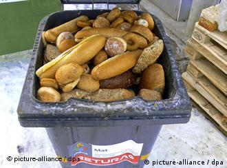 A bin filled with discarded bread rolls