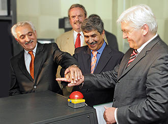 German Foreign Minister Steinmeier and Afghan Foreign Minister Spanta press a button