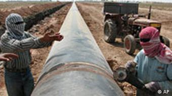 Workers on a natural gas pipeline in Iraq