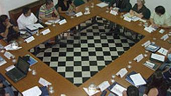 The participants sit at a table