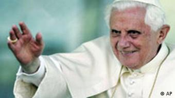 Pope Benedict XVI waves from the Popemobile