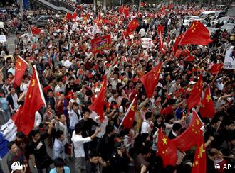 Hundreds of protesters holding Chinese flags outside French supermarket Carrefour in Hubei province