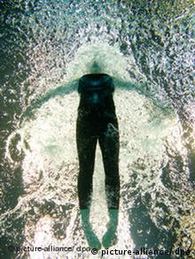 Person swimming the butterfly