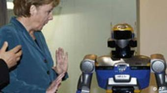 German Chancellor Angela Merkel with a robot at the Hanover Trade Show