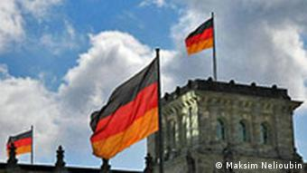 German flags on the Bundestag building in Berlin