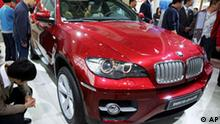 Visitors look at a BMW X6 at the Auto China 2008 auto show in Beijing Tuesday, April 22, 2008. Auto sales in China are booming, with analysts and automakers forecasting growth at 15-20 percent this year. (AP Photo/Greg Baker)