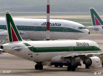 Alitalia planes are seen on the tarmac of the Milan Malpensa Airport